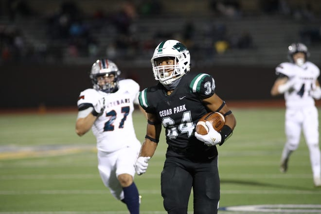 Cedar Park's Josh Cameron breaks away for the Timberwolves' first touchdown in their 61-28 win over Corpus Christi Veterans Memorial on Friday in San Antonio. With the victory, Cedar Park advanced to the state final.
