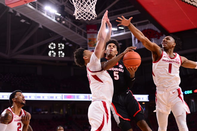 Georgia guard Justin Kier drives against Arkansas in an SEC basketball game on Jan. 9, 2021