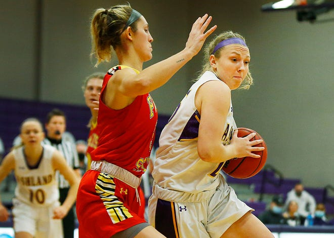 Ashland University's Karlee Pireu (25) drives to the basket as Ferris State's Zoe Anderson (3) defends during AU's 79-55 season-opening win Friday at Kates Gymnasium.