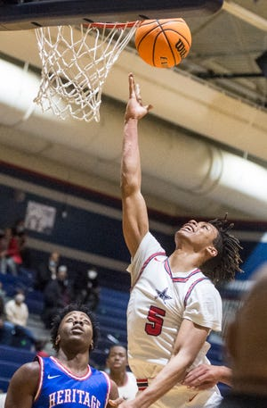 Grovetown's Zach Bell takes a shot during basketball action against Heritage at Grovetown High School in Grovetown, Ga., Friday evening January 8, 2021.
