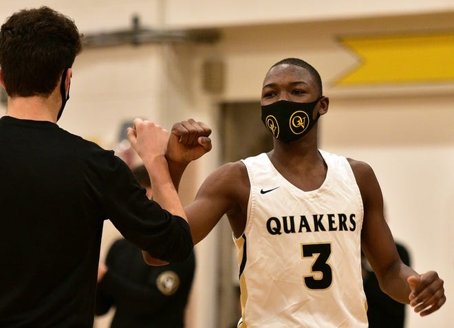 Quaker Valley's Amadou Thiero (3) bumps fists with a teammate before their game against Montour at Quaker Valley High School Friday.
