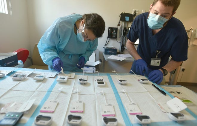 Medical workers run COVID-19 tests on nose swabs taken at the Outer Cape Health test site in Wellfleet. Outer Cape Health Services has conducted more than 1,300 Binax tests at locations in Harwich, Wellfleet and Provincetown since Dec. 23,  CEO Patricia Nadle said.