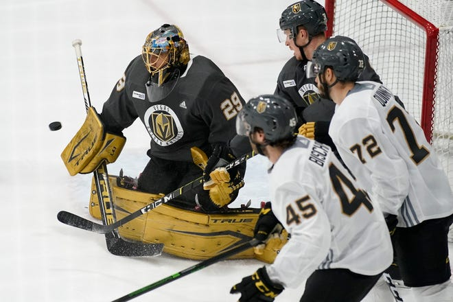 Vegas Golden Knights goaltender Marc-Andre Fleury blocks a shot during training camp Wednesday.