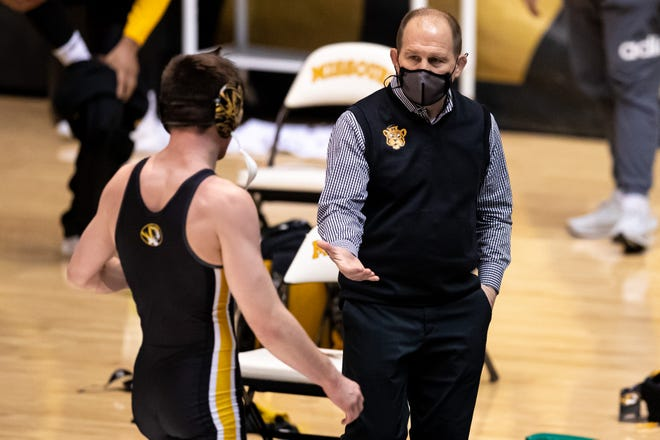 Missouri head wrestling coach Brian Smith greets one of his wrestlers Friday at the Hearnes Center. The Tigers defeated Central Michigan and Wyoming in their first home action of the season.