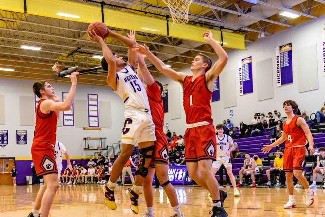 Hickman's TJ Turner (15) takes a shot during a game against Ozark on Friday night at Hickman High School.