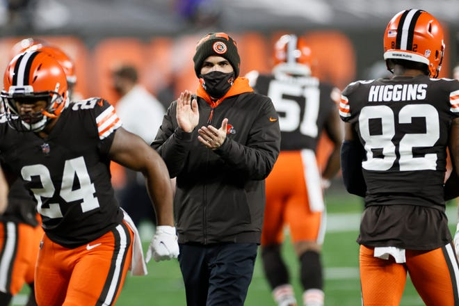 Browns head coach Kevin Stefanski keeps watch before a game against the Baltimore Ravens, Monday, Dec. 14, 2020, in Cleveland. Stefanski said he has been experiencing mild COVID-19 symptoms but expects to rejoin the team in person on Thursday. [Ron Schwane/Associated Press]