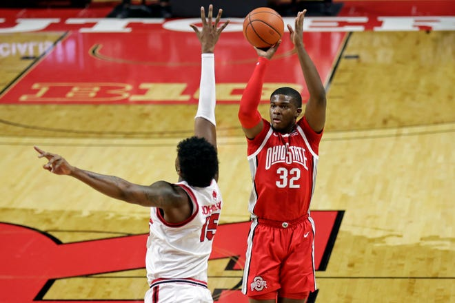 Ohio State forward E.J. Liddell (32) shoots over Rutgers center Myles Johnson during the first half of an NCAA college basketball game Saturday, Jan. 9, 2021, in Piscataway, N.J. [Adam Hunger/Associated Press]