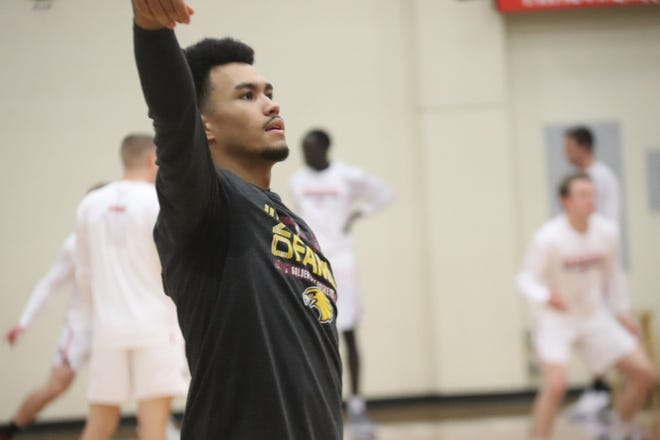 Ethan Channel warms up before a game against Minnesota State Moorhead on Saturday, Jan. 9. Channel led the Golden Eagles with 18 points on Friday at Northern State.