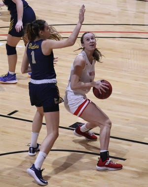 Wheeling University's Lilly RItz, a Cambridge High graduate looks for an opening during Thursday night's season opener with Alderson-Broaddus. Ritz finished with a team-high 23 points and added 15 rebounds to lead the Lady Cardinals to a 76-63 win in the season opener.
