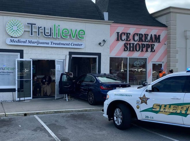 A car rams through the front of the Trulieve in Destin on Saturday.