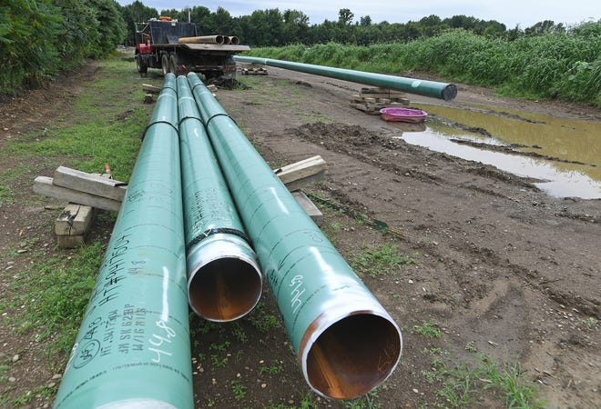 Shown in this Aug. 22, 2019, photo, 12-inch-wide natural gas transmission pipes lay beside U.S. Route 20 (not shown) in North Kingsville, Ohio. The construction of the $86 million Risberg Pipeline system added 28 new miles of pipe and upgraded 60 miles of pipe that transport natural gas from national transmission lines through parts of Erie County to a Dominion Energy distribution station in North Kingsville.