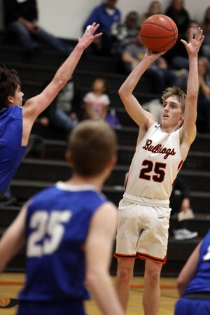 """Mediapolis High School's Cory Virgin (25) shoots the ball during the first half of their game against Columbus Community High School, Friday Jan. 8, 2021 at Mediapolis Vernon """"Bud"""" McLearn Court."""