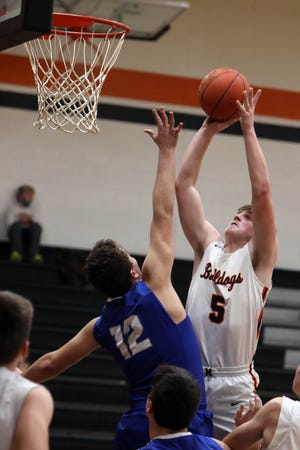 """Mediapolis High School's Cole Lipper (5) goes up for a basket during the first half of their game against Columbus Community High School, Friday Jan. 8, 2021 at Mediapolis Vernon """"Bud"""" McLearn Court."""