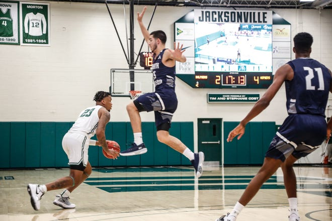 Jacksonville University's Tyreese Davis dribbles past Jose Placer of the University of North Florida during Friday's game at Swisher Gym. JU defeated UNF 66-65