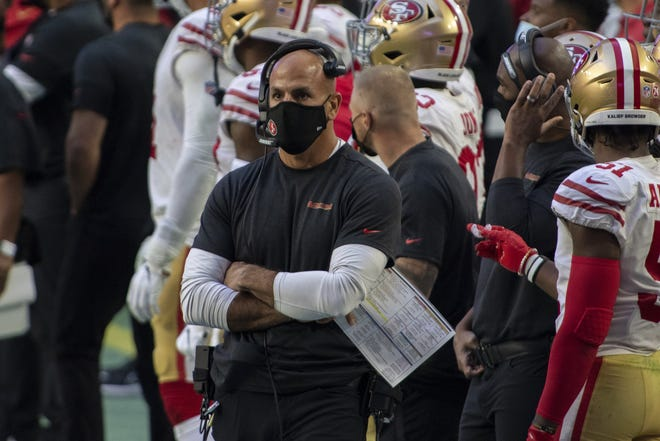 San Francisco 49ers defensive coordinator Robert Saleh looks on during an NFL football game against the Seattle Seahawks, Sunday, Jan. 3, 2021, in Glendale, Ariz. (AP Photo/Jennifer Stewart)