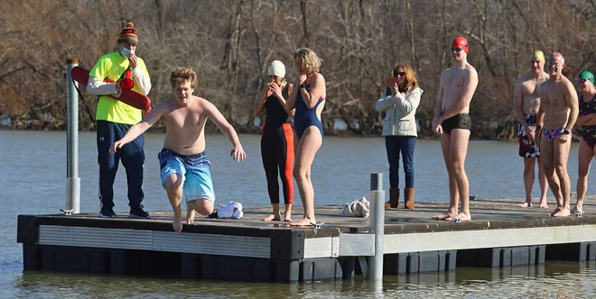 James Andrews takes the plunge during the first Polar Plunge & Oyster Roast with proceeds going to help adult swim programs and COVID relief Saturday afternoon, Jan. 9, 2021, at the Riverside Marina in Belmont.