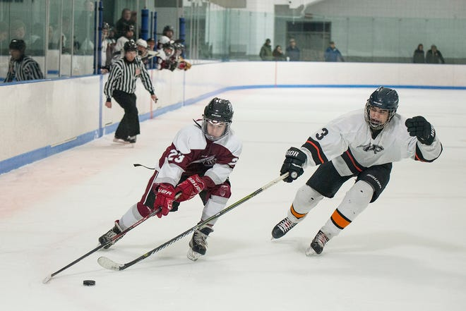 Murdock senior Philip Quinn (3), shown defending a Fitchburg/Monty Tech forward in a game from last year, returns for his fifth season defending the Wildcats' blue line this winter.