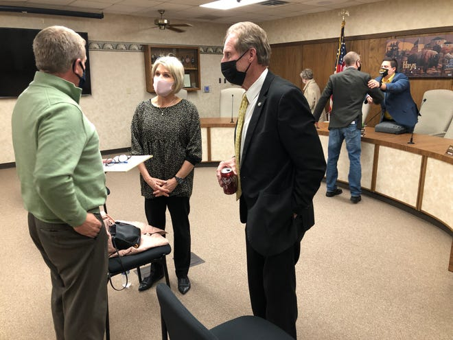 Hays city manager Toby Dougherty, left, talks with Rep. Barb Wasinger, center, and Sen. Rick Billinger, right, after the legislators briefed the city commission on Thursday about the 2021 legislative session.