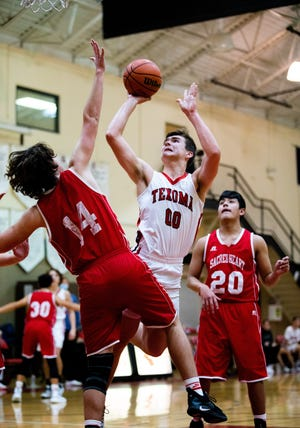 Texoma Christian's Thomas Barnett finished with 19 points and 17 rebounds in a district-opening victory against Muenster Sacred Heart at TCS