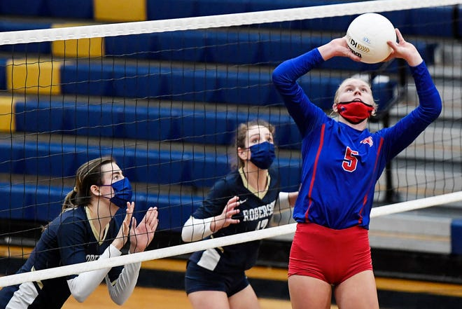 West Henderson's Malia Moore sets the ball in the game against T.C. Roberson in Arden on Dec. 3. The Rams won, 3-2.