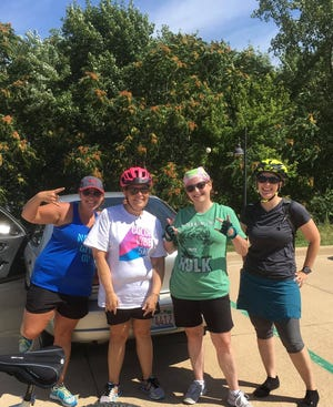 Sarah Gray, right, is shown in this 2016 photo with members of a group of friends who often would go on bicycle rides on Sunday mornings. Gray, an outdoors enthusiast, was found dead Friday morning after a kayak mishap on the Illinois River north of Peoria.