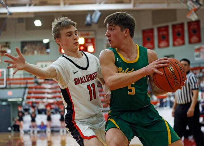 Shallowater's Caden Gillespie (11) defends Idalou's William Wall (4) during the basketball game against Idalou, Friday, Jan. 8, 2021, in Shallowater, Texas.