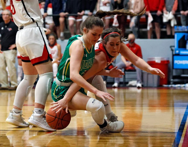 Shallowater's Kami Wood (5) falls while trying to steal the ball from Idalou's Emmy Craig (22) during a District 2-3A game Friday at Shallowater High School. Wood helped the No. 1 Fillies claim a 59-45 in over the No. 2 Lady Wildcats.