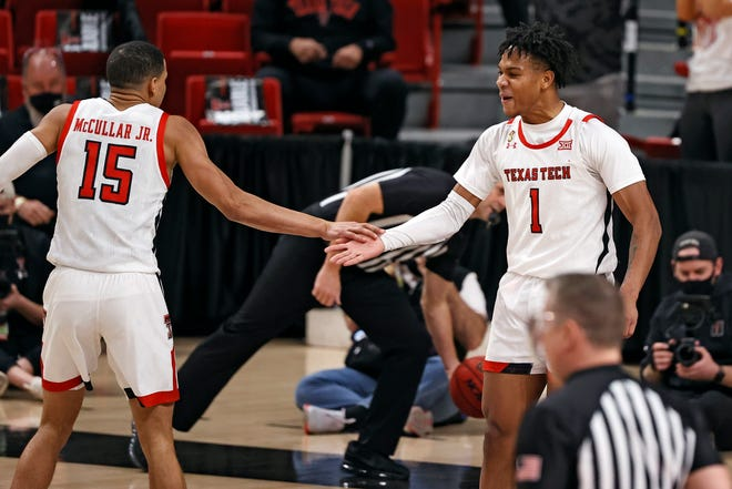 Texas Tech's Terrence Shannon Jr. (1) high-fives Kevin McCullar (15) after scoring a three-point shot during the second half of a Big 12 Conference game Tuesday against Kansas State at United Supermarkets Arena. [AP Photo/Brad Tollefson]