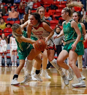Idalou's Jaycee Spain (1) tries to steal the ball from Shallowater's Taylor Moravcik (31) during a District 2-3A game Jan. 8 at Shallowater High School.