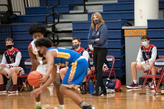 Lincoln-Sudbury head coach Linda Martindale watches the action on the court during the game in Sudbury against Acton-Boxborough, Jan. 8, 2021. Acton-Boxborough defeated the Warriors, 55-44.