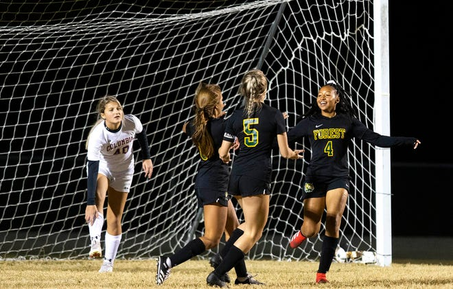 Forest's Kania Dean celebrates her goal in the first half. The Wildcats defeated the Tigers 7-0, Friday night.