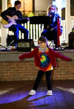 The First Friday Art Walk always includes music on the Ocala downtown square.