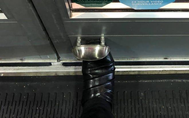 Foot door opener at Vinnie's Italian Grill and Pizzeria in Midlothian, Va. in Dec. of 2020.