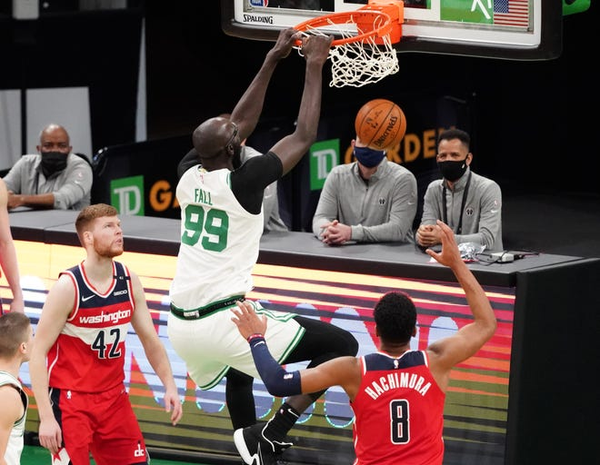 Jan 8, 2021; Boston, Massachusetts, USA; Boston Celtics center Tacko Fall (99) makes the basket against the Washington Wizards in the fourth quarter at TD Garden. Mandatory Credit: David Butler II-USA TODAY Sports