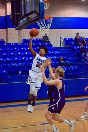 Winters' Alex Rodriguez elevates over a Roscoe defender to drop in a layup in the Blizzards' 78-10 over the Plowboys in Winters on Friday.