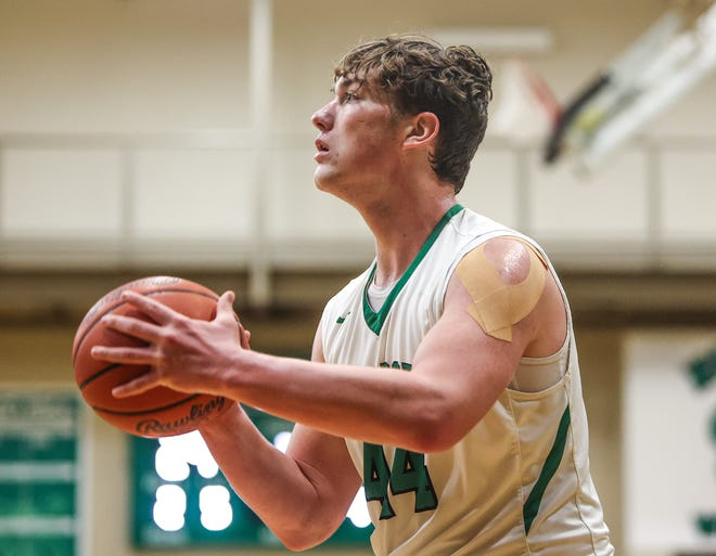 Mogadore sophomore Mason Williams lines up a three-pointer from the corner during Friday night's game against Lake Center Christian at Mogadore High School.