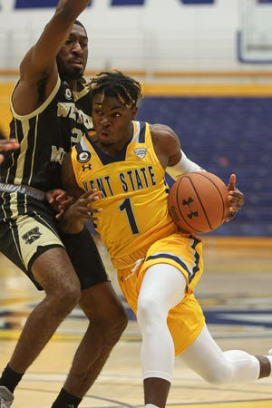 Kent State senior guard Michael Nuga drives to the basket during Saturday's game against Western Michigan at the M.A.C. Center.
