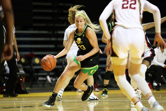 Oregon guard Maddie Scherr (23) drives against Stanford during the first half of Friday's game. The Ducks will be looking to end a two-game Pac-12 Conference losing streak when they play at California on Sunday.