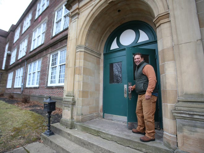 Gary Gergley is shown outside the former Wells School in Canton. He has continued renovations started by his daughter in 2019.