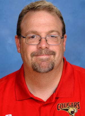 Chad Davis is the new volleyball coach at Cardinal Mooney Catholic High School