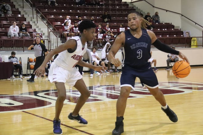 Shawnee's Jaylon Orange (3) attempts to drive past Ardmore's DD Coleman Friday during semifinal action of the East Central Oklahoma Classic at Ada High School.