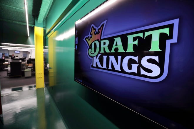 The DraftKings logo is displayed at the sports betting company headquarters in Boston.