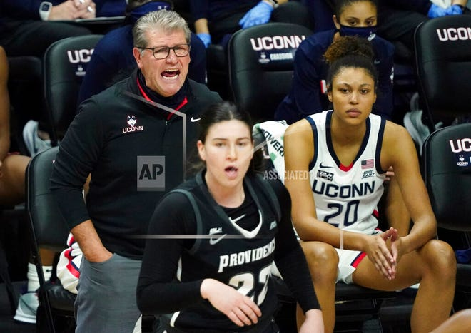 Connecticut head coach Geno Auriemma shouts from the sideline during the first half of an NCAA college basketball game against Providence at Harry A. Gampel Pavilion, Saturday, Jan. 9, 2021, in Storrs, Conn.