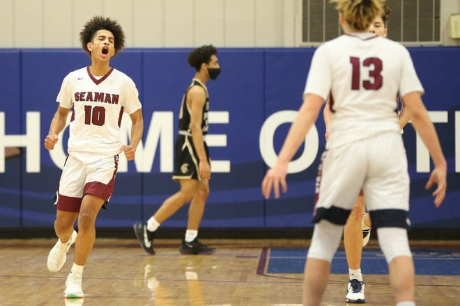 Seaman junior Mateo Hyman celebrates after scoring two in the first half of Friday's game against Topeka High. The Vikings won 50-48.