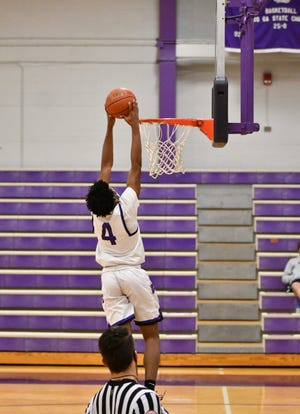 Topeka West's Elijah Brooks goes up for a dunk during the second half of Friday's 78-60 win over Hayden at West. Brooks scored 20 of his game-high 28 points to lead the Chargers.