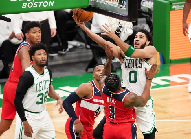 Celtics forward Jayson Tatum drives the ball to the basket against Wizards guard Bradley Beal (3) in the second quarter at TD Garden.
