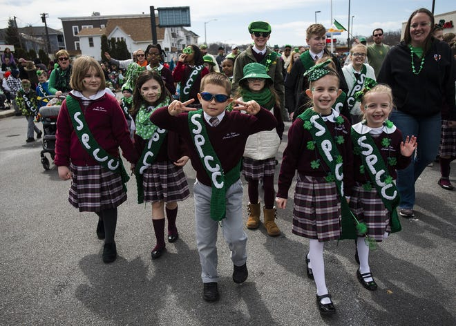Students from St. Peter Central Catholic Elementary School march in the 2019 Worcester County St. Patrick's Parade in Worcester.