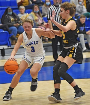Etowah's Jaleigh Devine drives to the basket as Cherokee County's Ella Garmany defends during high basketball action in Attalla, Alabama January 8, 2021.