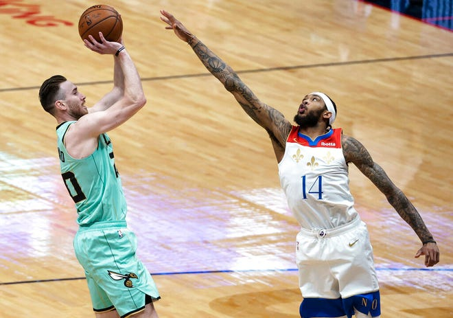 Charlotte Hornets forward Gordon Hayward (20) shoots over New Orleans Pelicans forward Brandon Ingram (14) during the first quarter of an NBA basketball game in New Orleans, Friday, Jan. 8, 2021. (AP Photo/Derick Hingle)