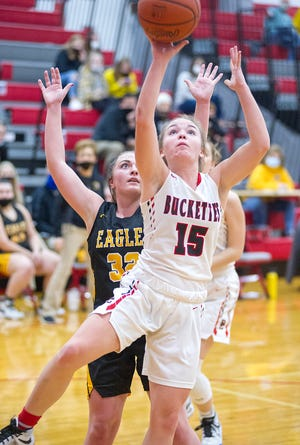 Buckeye Central's Taylor Ratliff shoots as Colonel Crawford's Kaylyn Risner looks on.